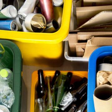 Recycle bins with various types of waste.